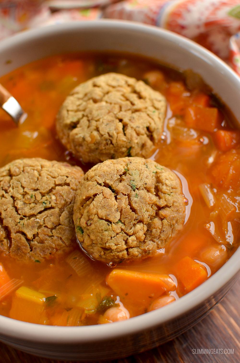 dumplings in bowl of vegetable and bean stew