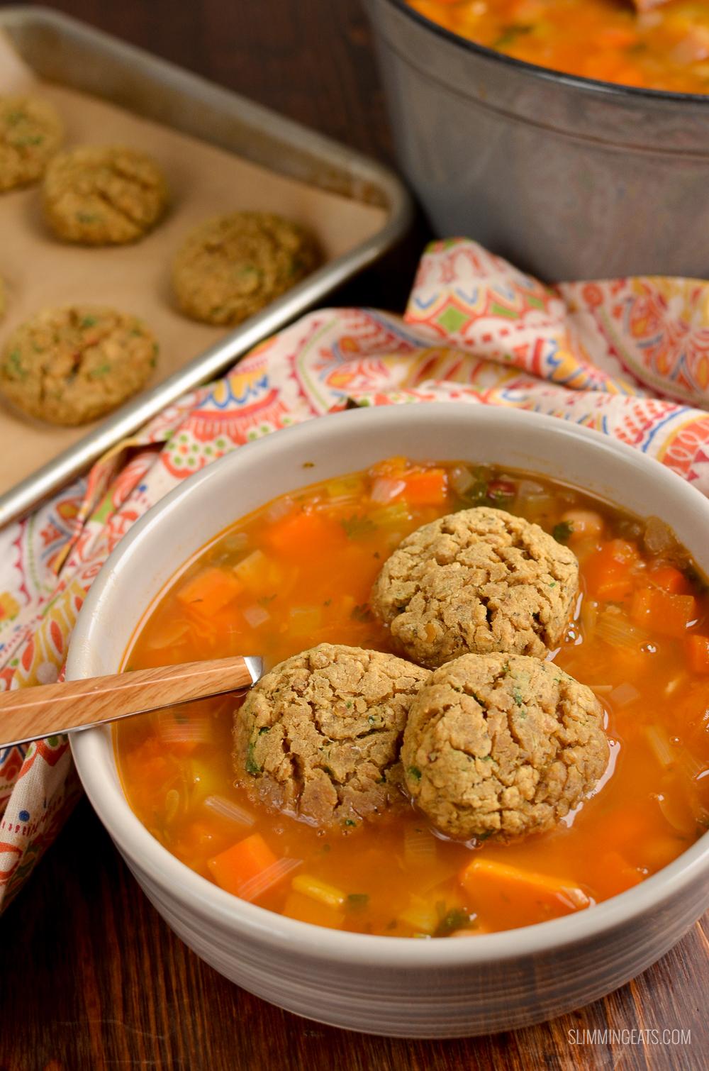 vegan lentil dumplings in vegetable bean stew with tray of dumplings in background