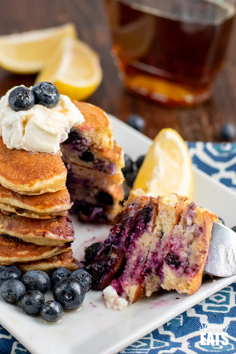 segment of sliced lemon blueberry oat pancakes on a fork