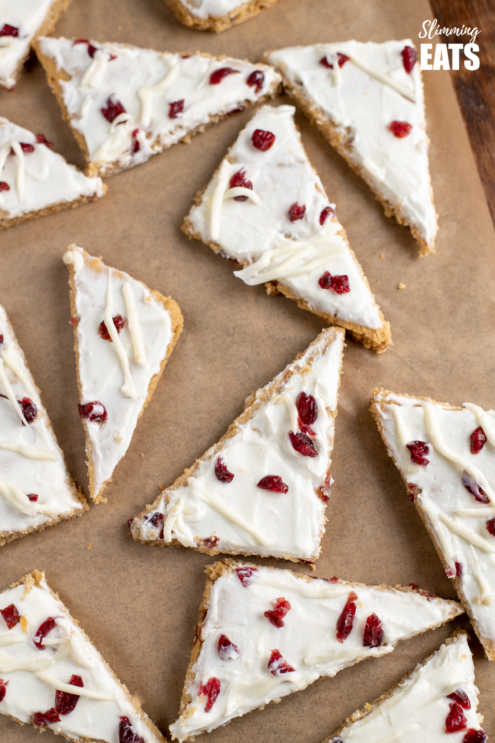 over the top view of cranberry bliss baked oat bars on parchment paper