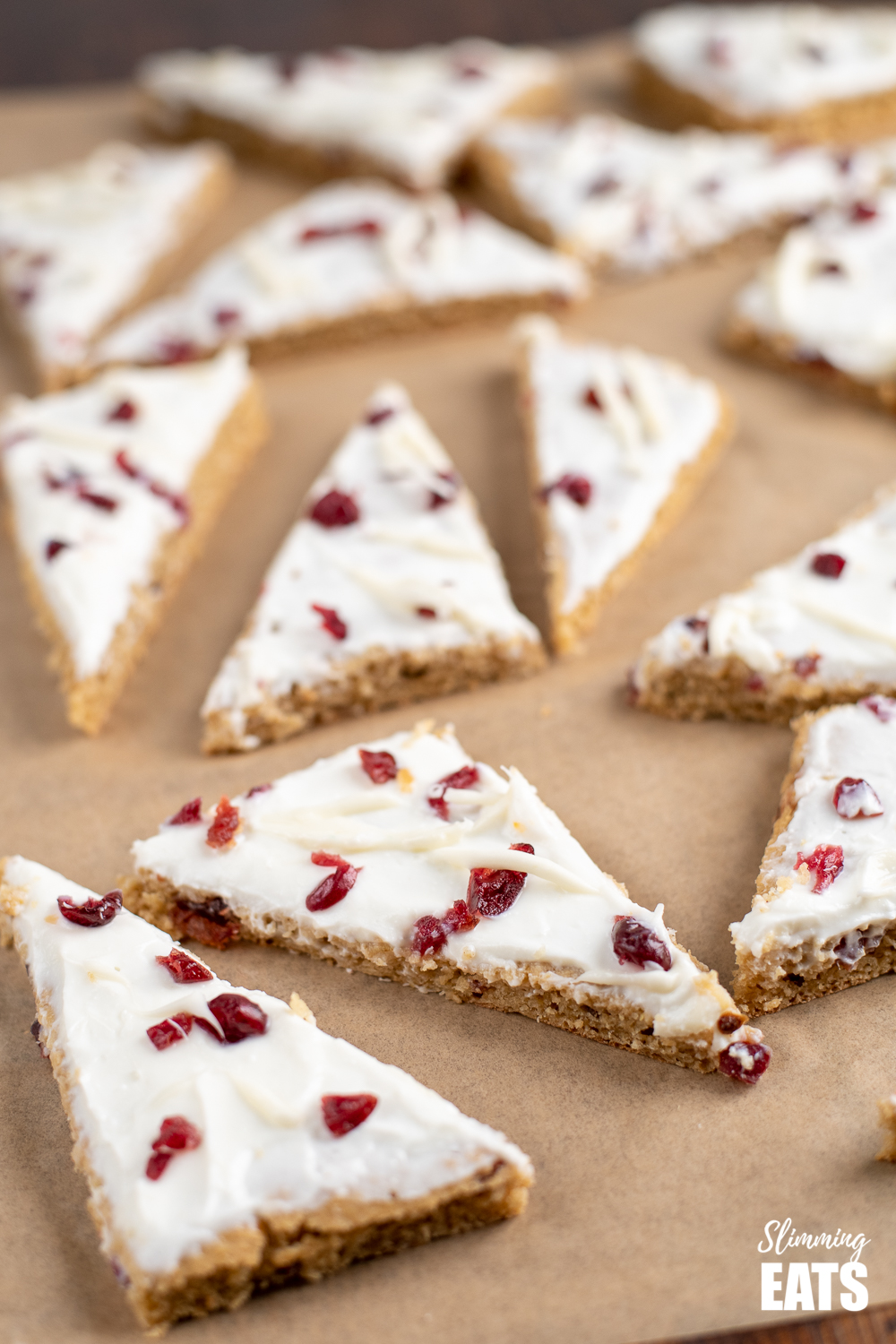 Cranberry Bliss Baked Oat Bars On Parchment