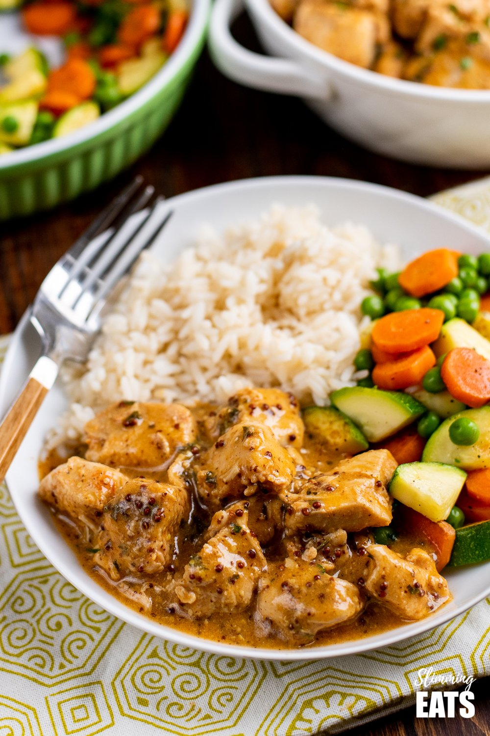 instant pot chicken in white bowl with rice and vegetables on patterned placemat