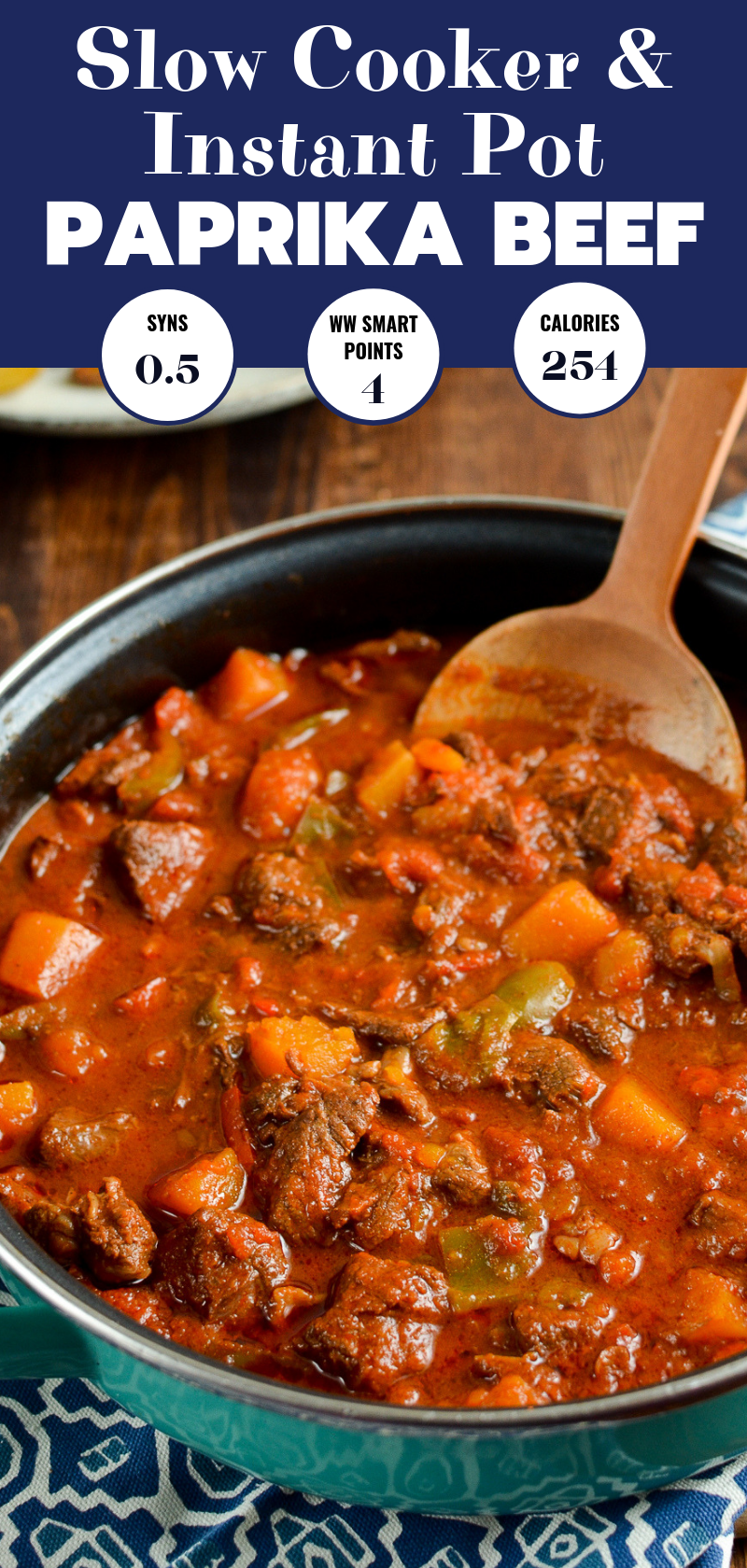 paprika beef in pan with wooden spoon pin