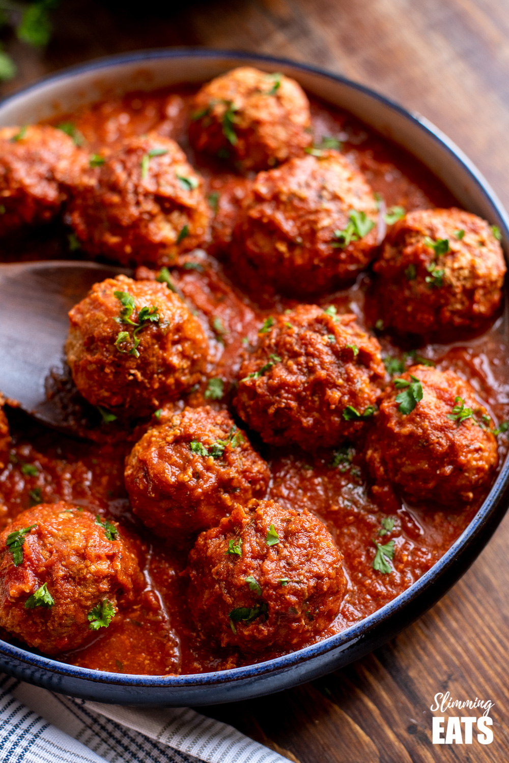 slow cooker Italian chicken meatballs with sauce in navy dish