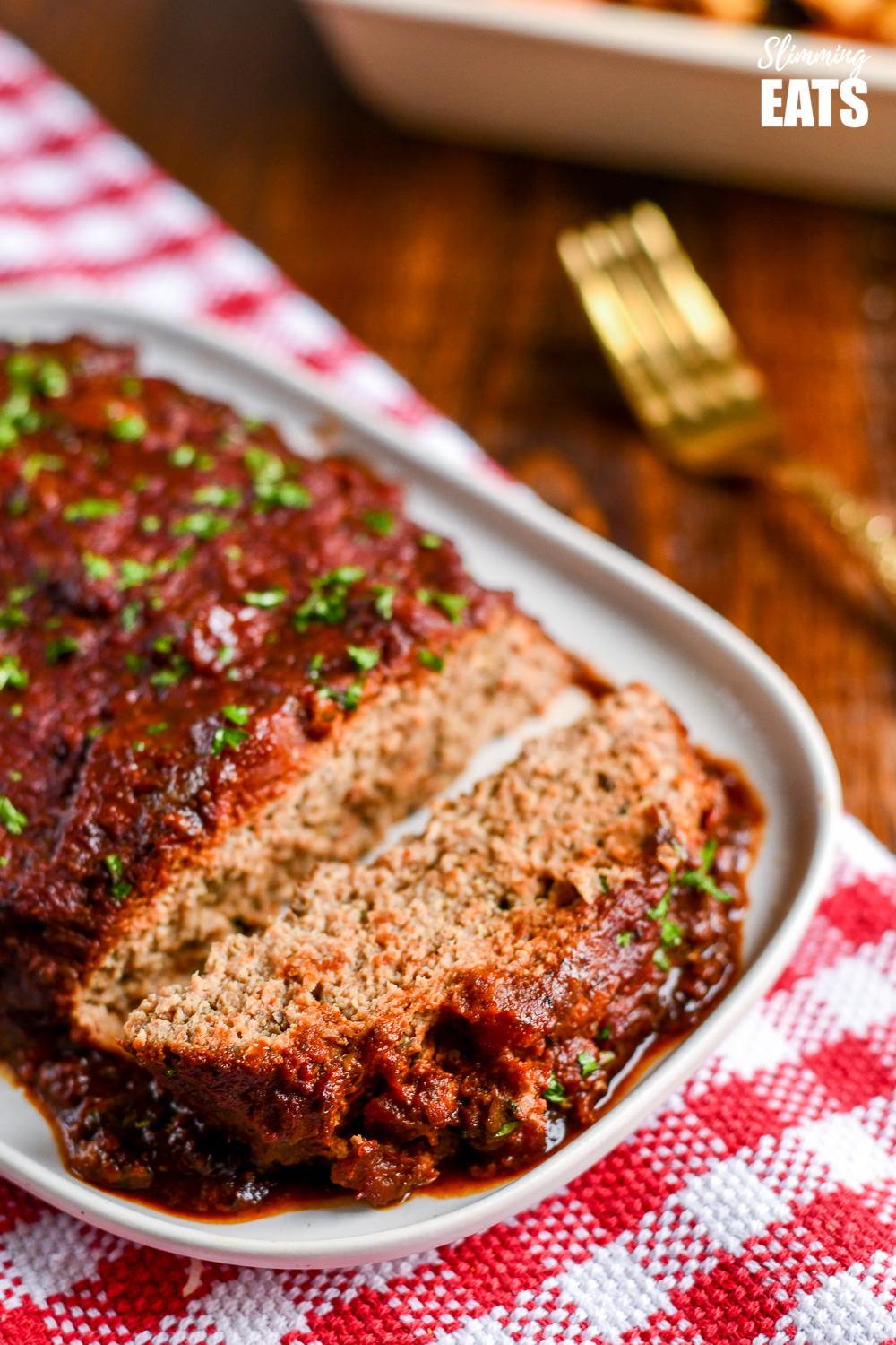 close up of sliced slow cooker chicken mushroom meatloaf on white plate