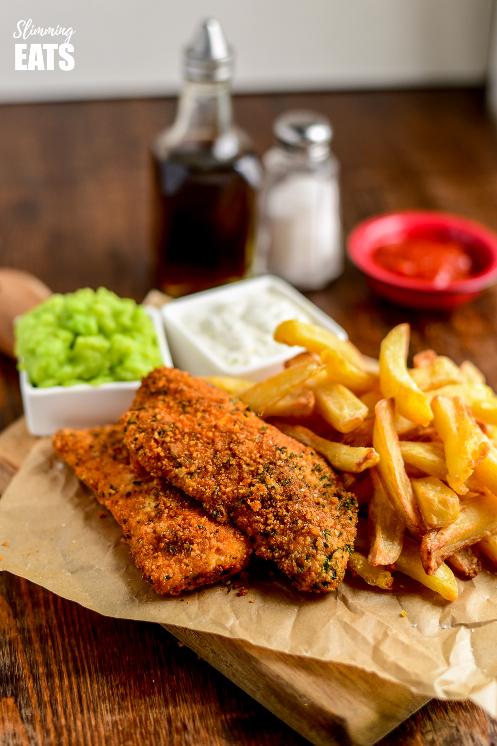 Actifry fish and chips on parchment with mushy peas and tartare sauce