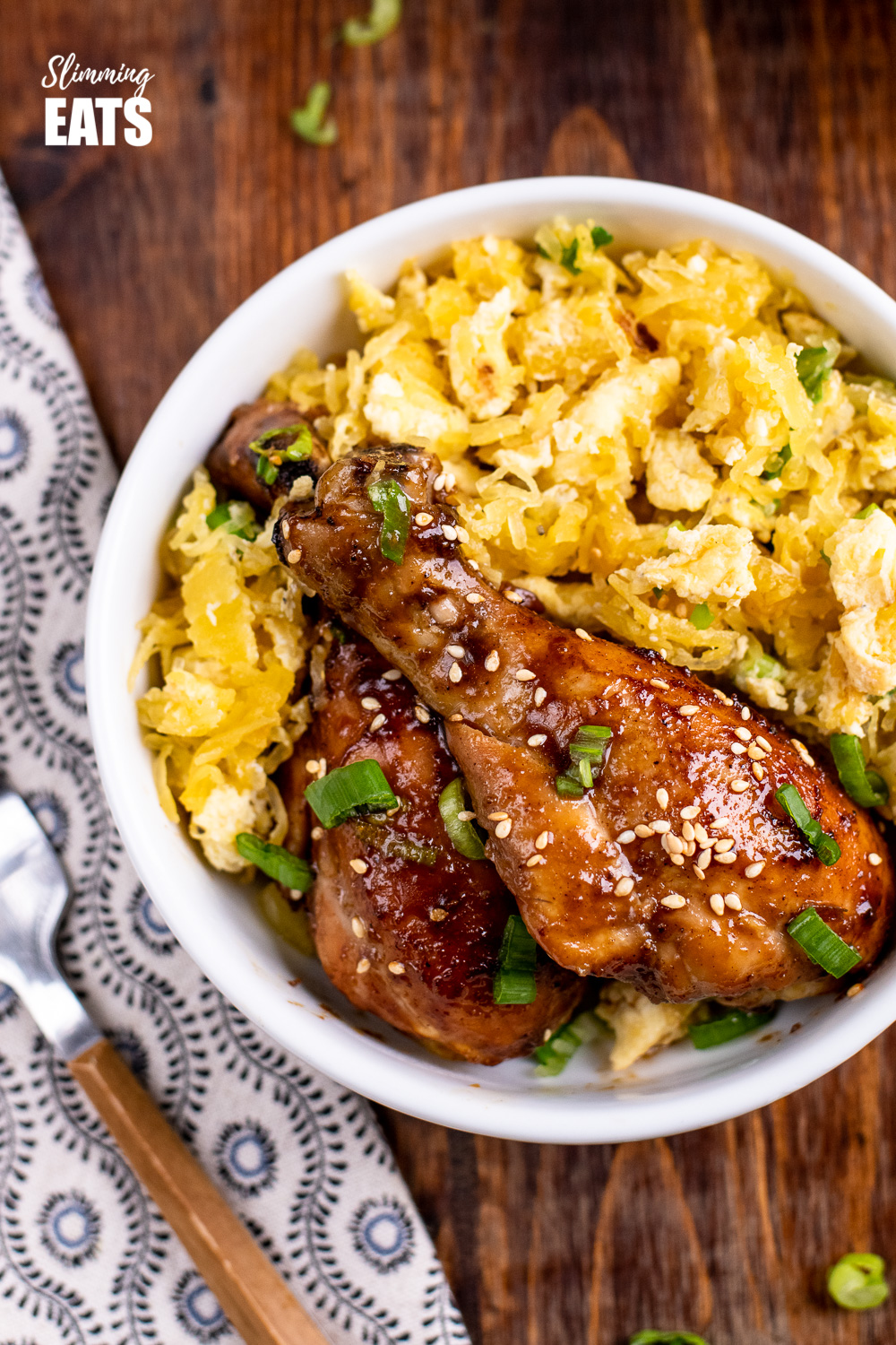 close up of Chinese five spice chicken in white bowl with egg fried spaghetti squash