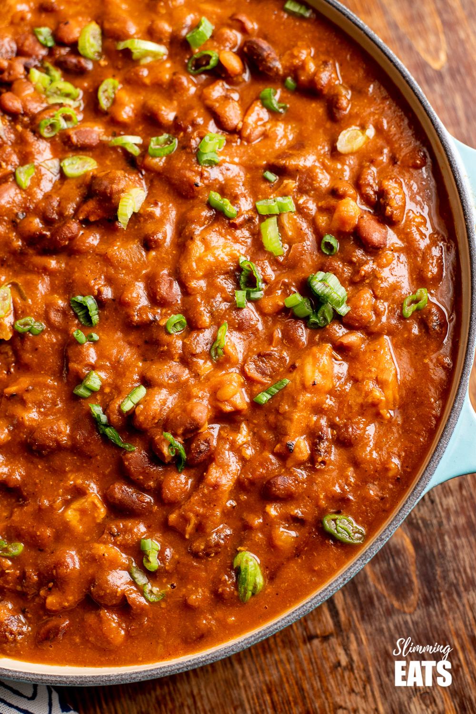 close up of Instant Pot Cajun Pork and Beans in cast iron pan