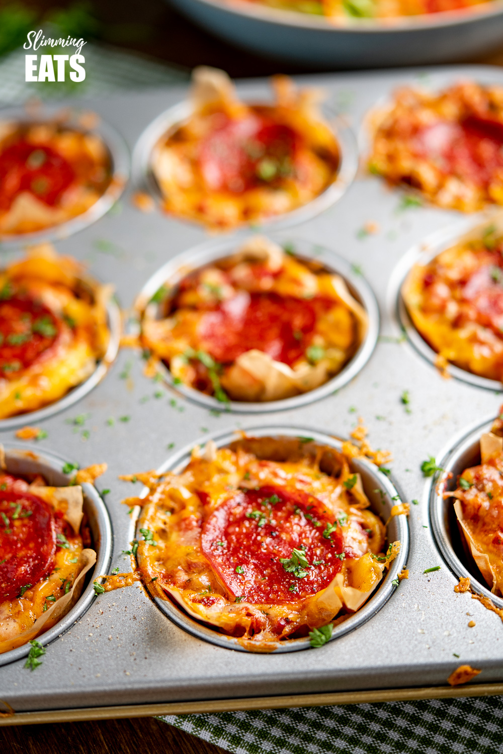 Pepperoni Pizza Egg Bites in a muffin tray