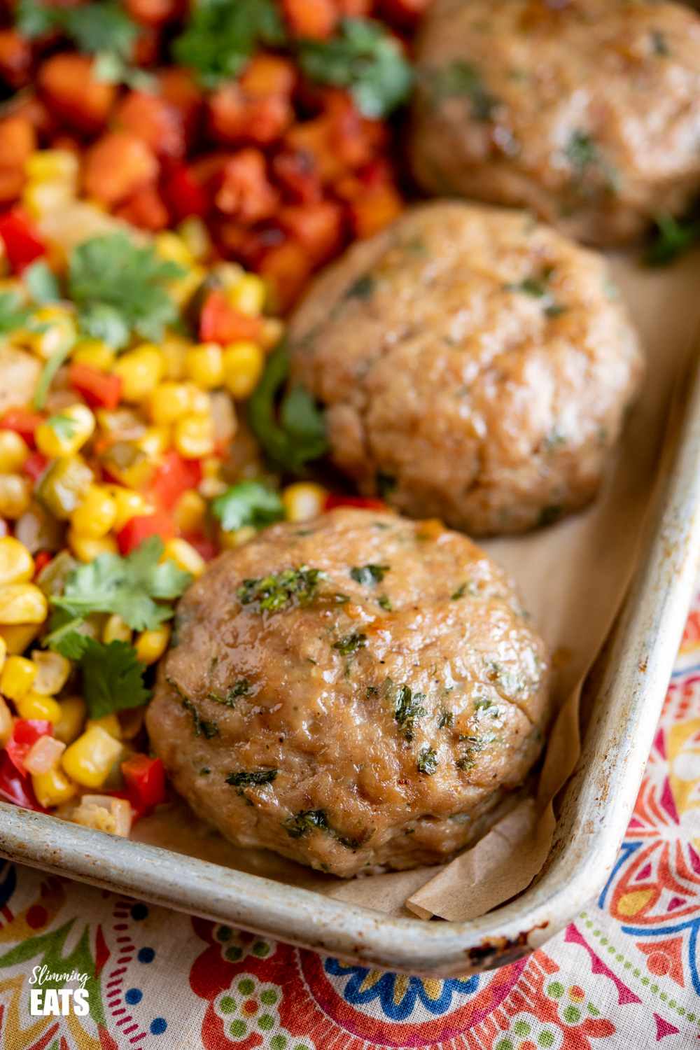 close up of chicken burgers on baking tray