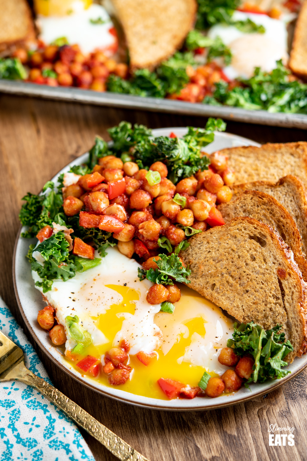 chickpea, egg and kale with crispy toast on plate