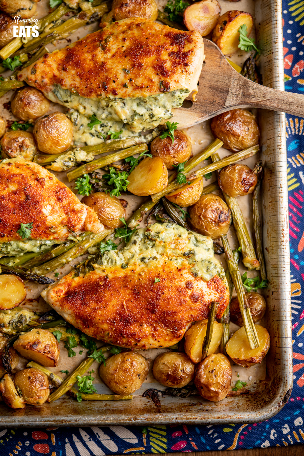 close up of Creamy Cheesy Spinach Stuffed Chicken on a baking tray
