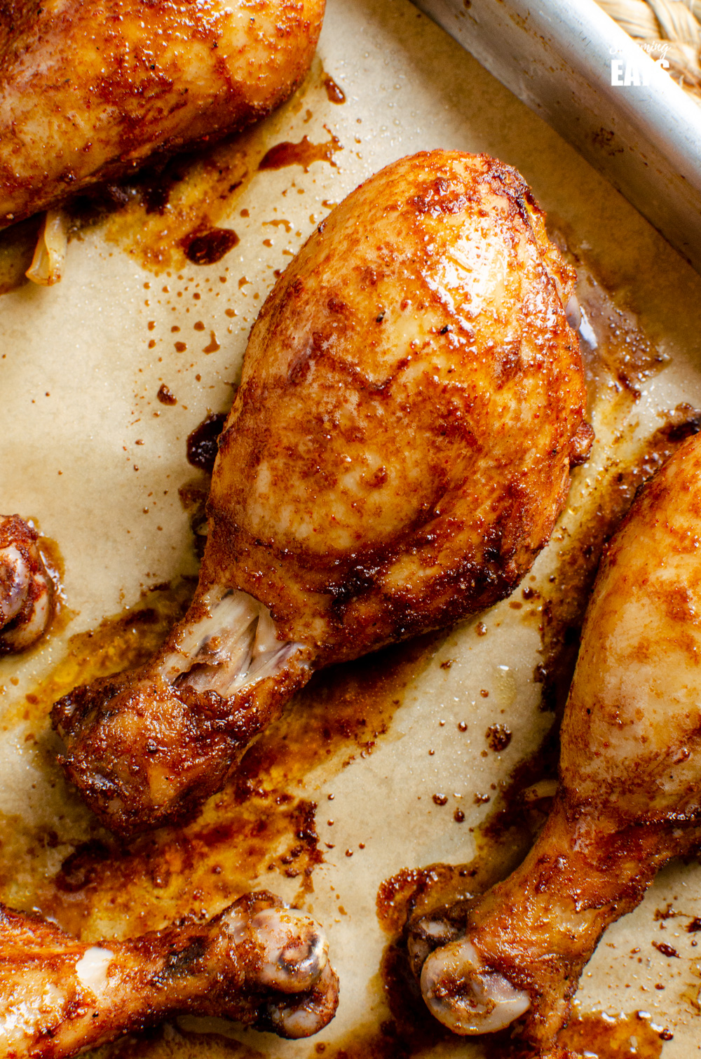 baked marinaded chicken drumsticks on a baking tray