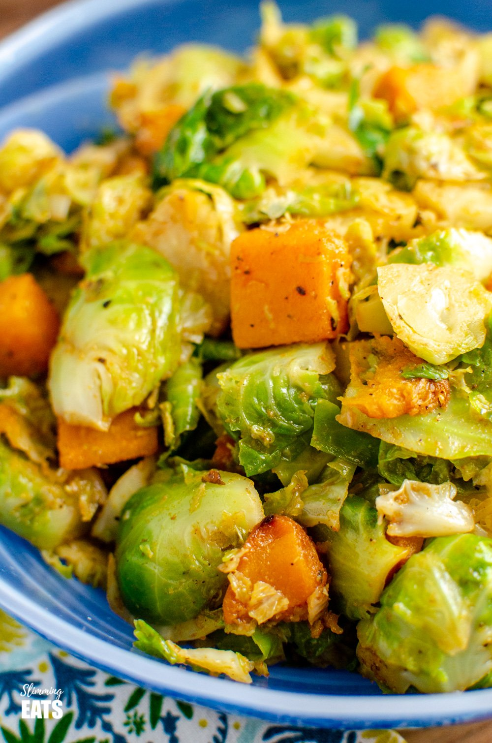 close up of  Brussels sprouts and butternut squash in blue bowl