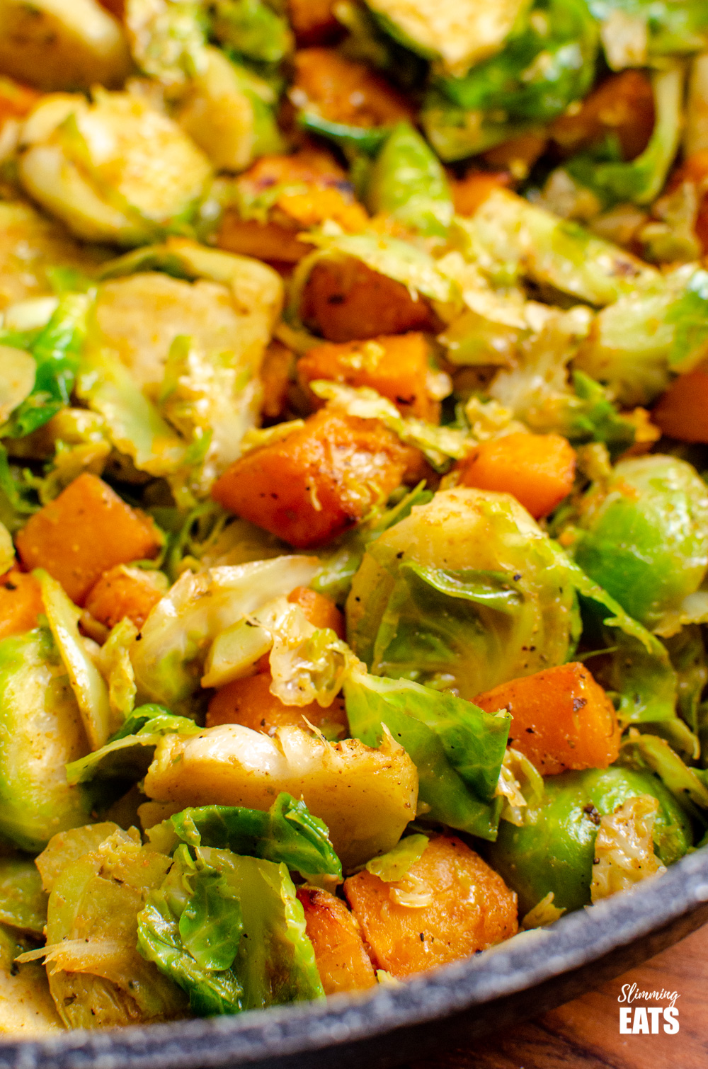 close up of Sautéed Brussel Sprouts with Roasted Butternut Squash in deep frying pan