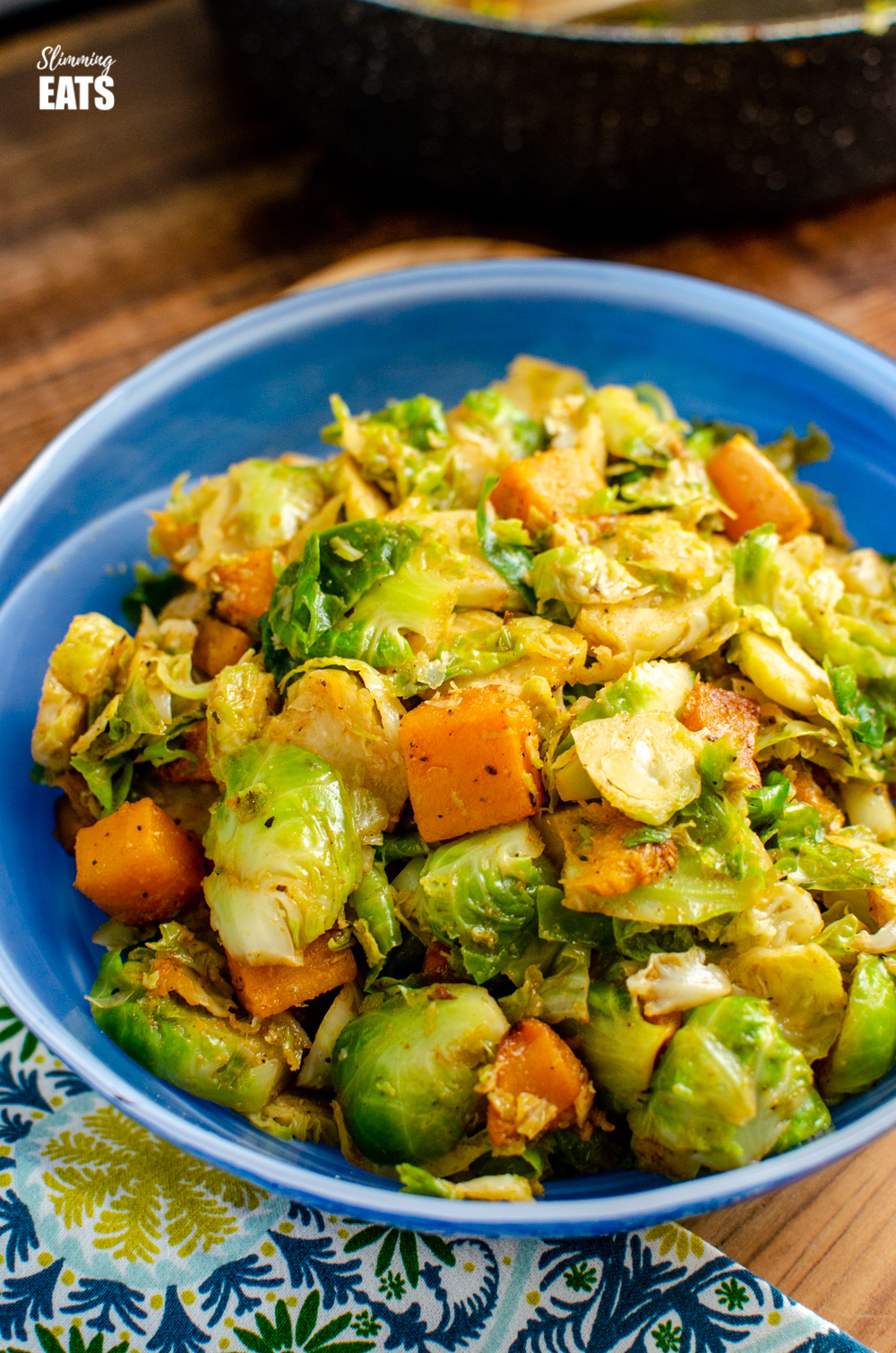 Brussels sprouts and butternut squash in blue bowl