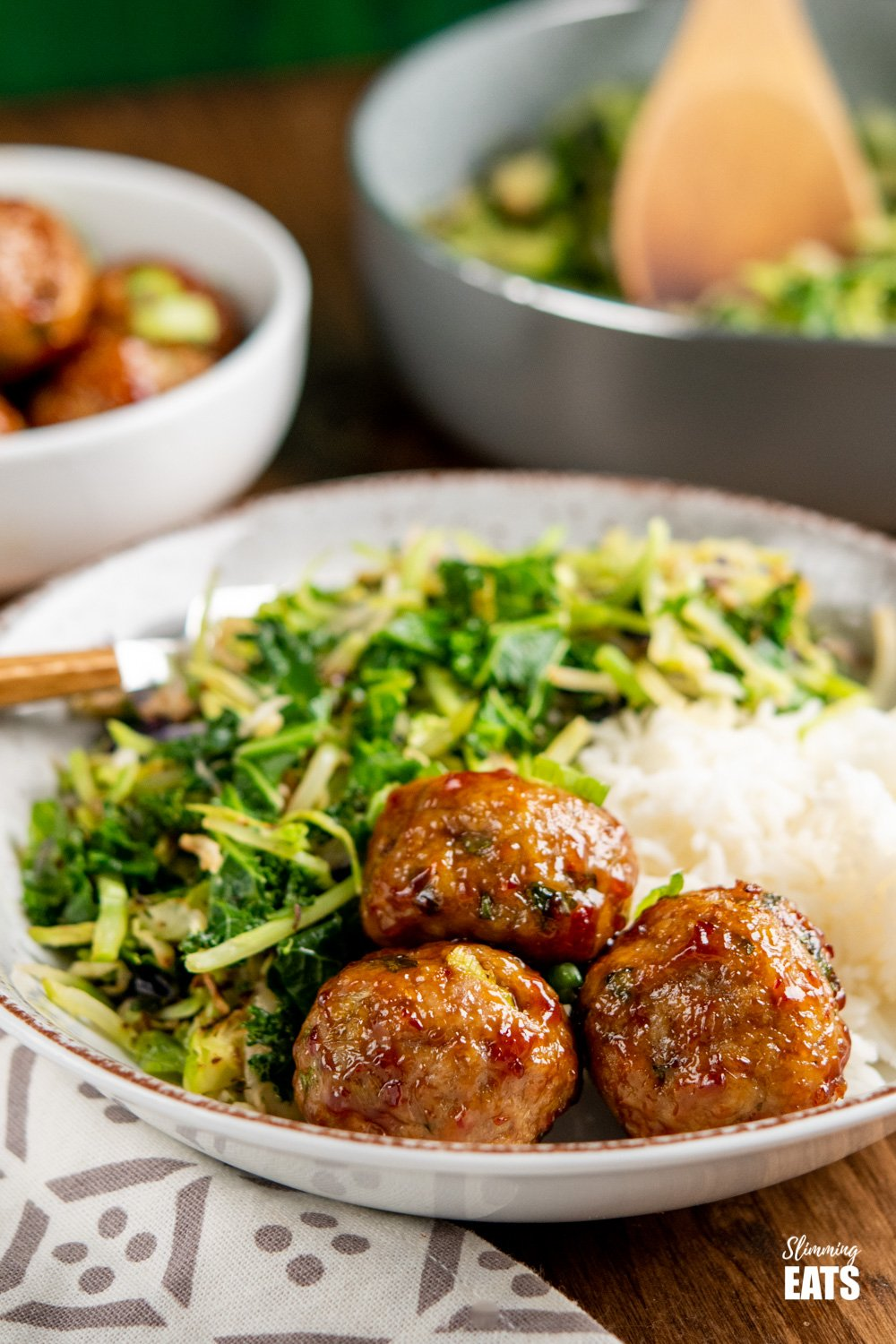 Sweet Chilli Chicken Meatballs with rice and veggies in bowl