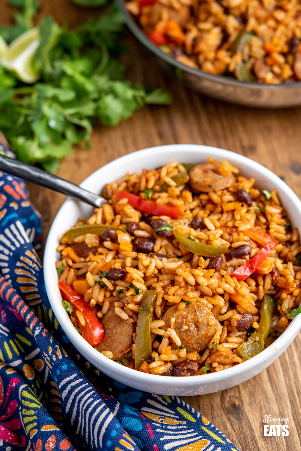 One Pot Cuban Style Rice in white bowl with black handled fork