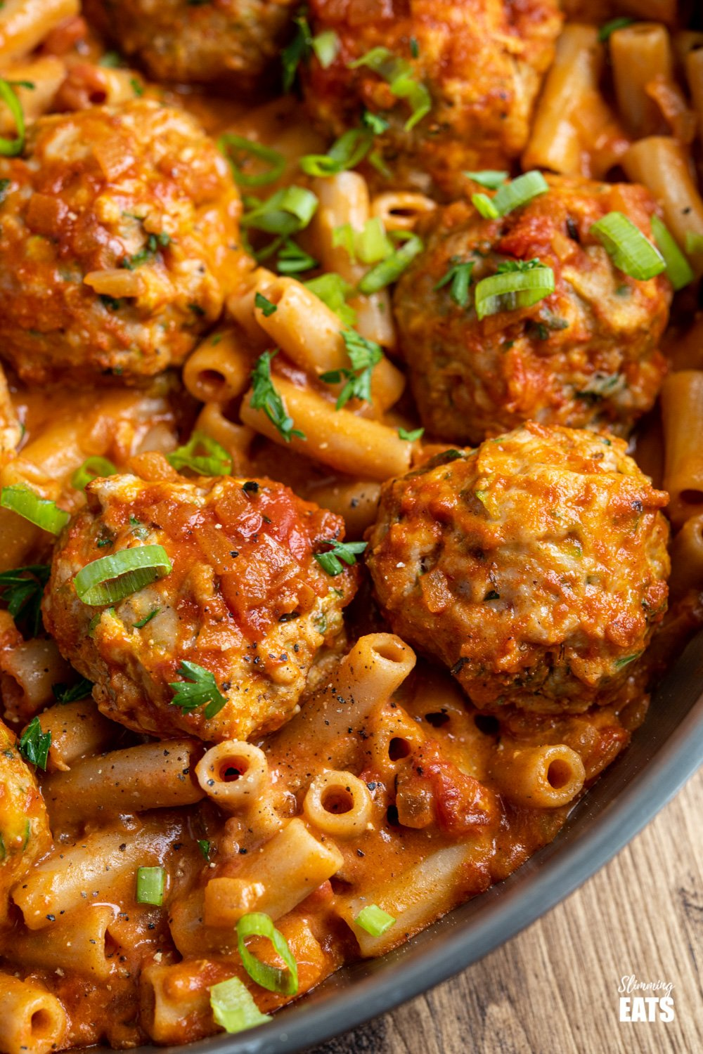 close up of creamy cajun chicken meatball pasta in frying pan