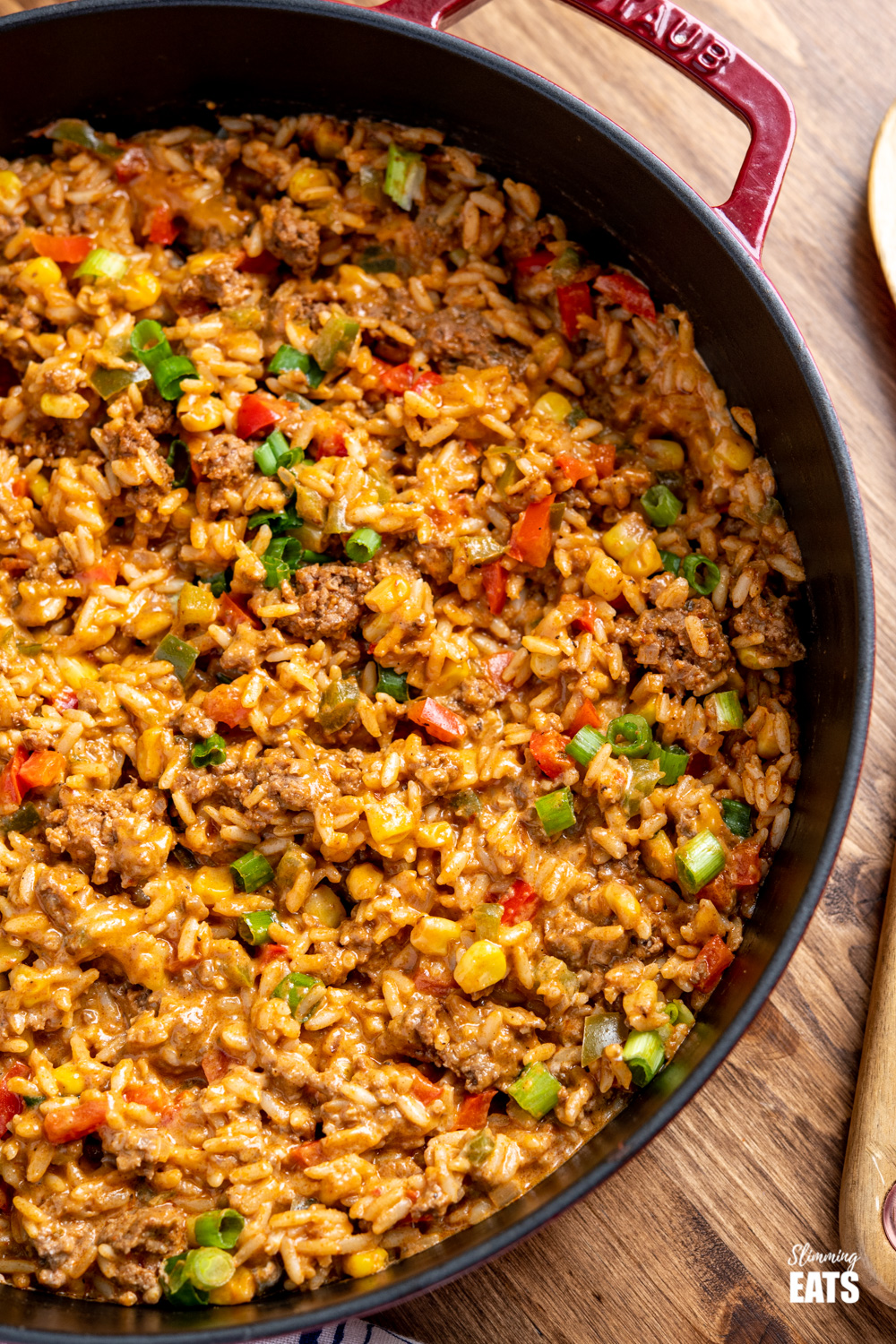 close up of Taco Beef Rice in red Staub cast iron skillet