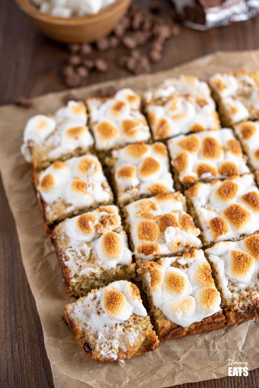 sliced toasted marshmallow oat bars on a sheet of parchment paper