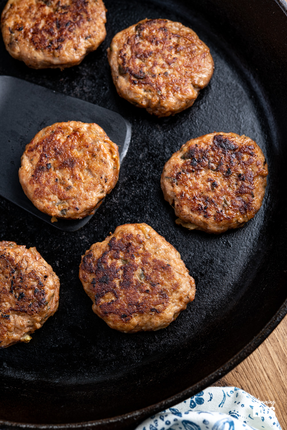 close up of cooked Turkey Breakfast Sausage Patties in a lodge cast iron skillet