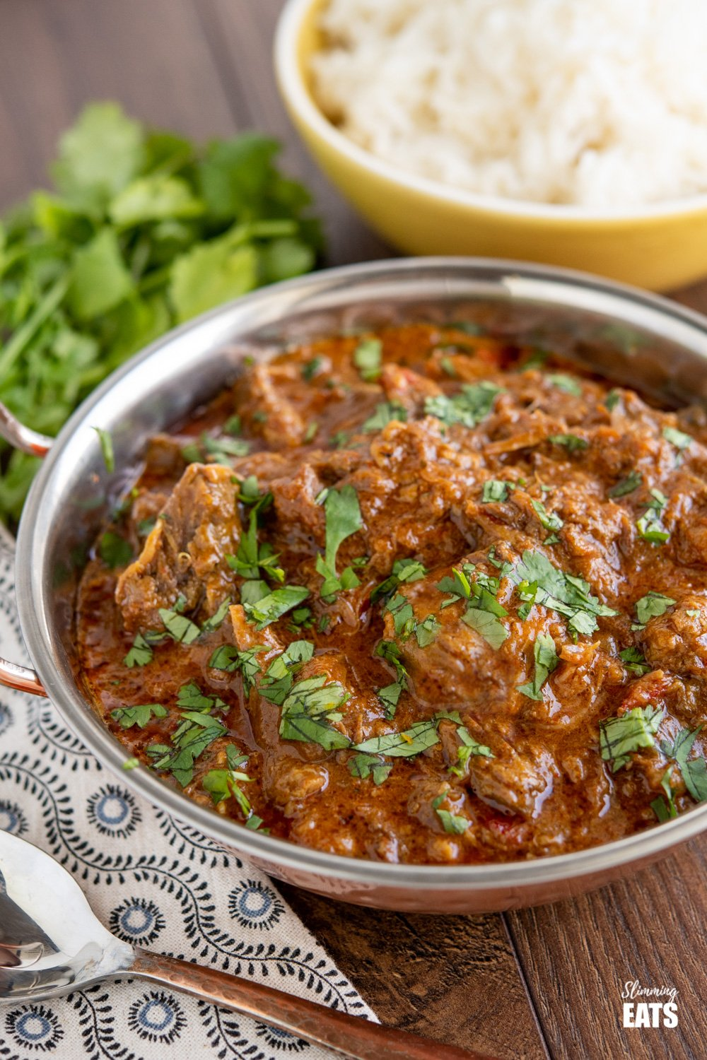 lamb bhuna in dish with rice in background