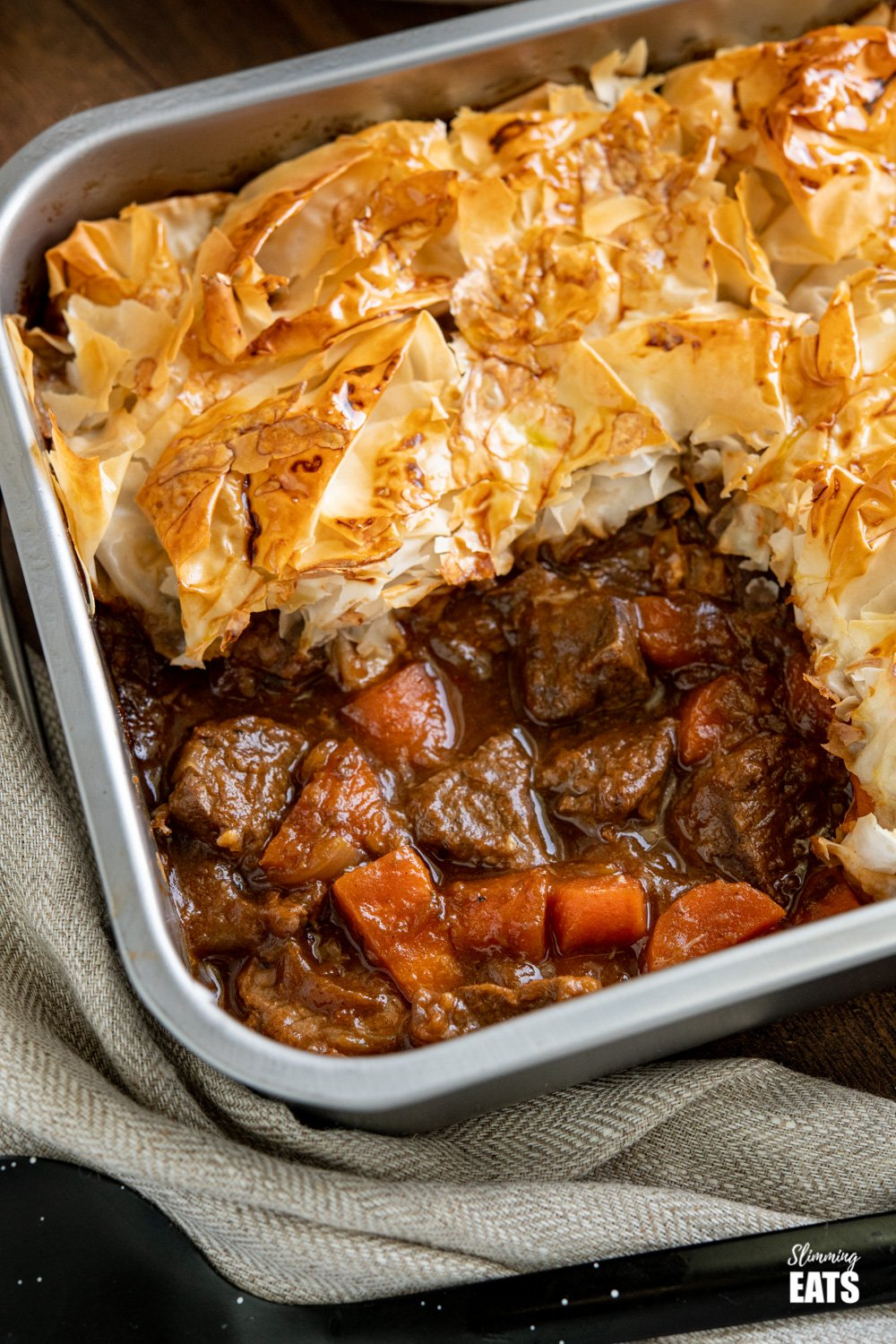 close up of Steak and Vegetable Pie in baking tin