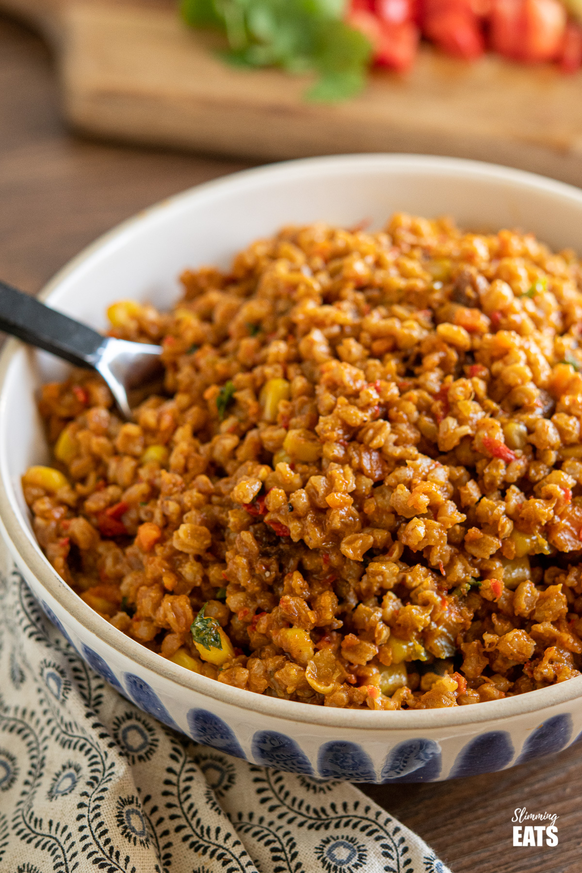 Spicy Farro Risotto in blue and white bowl