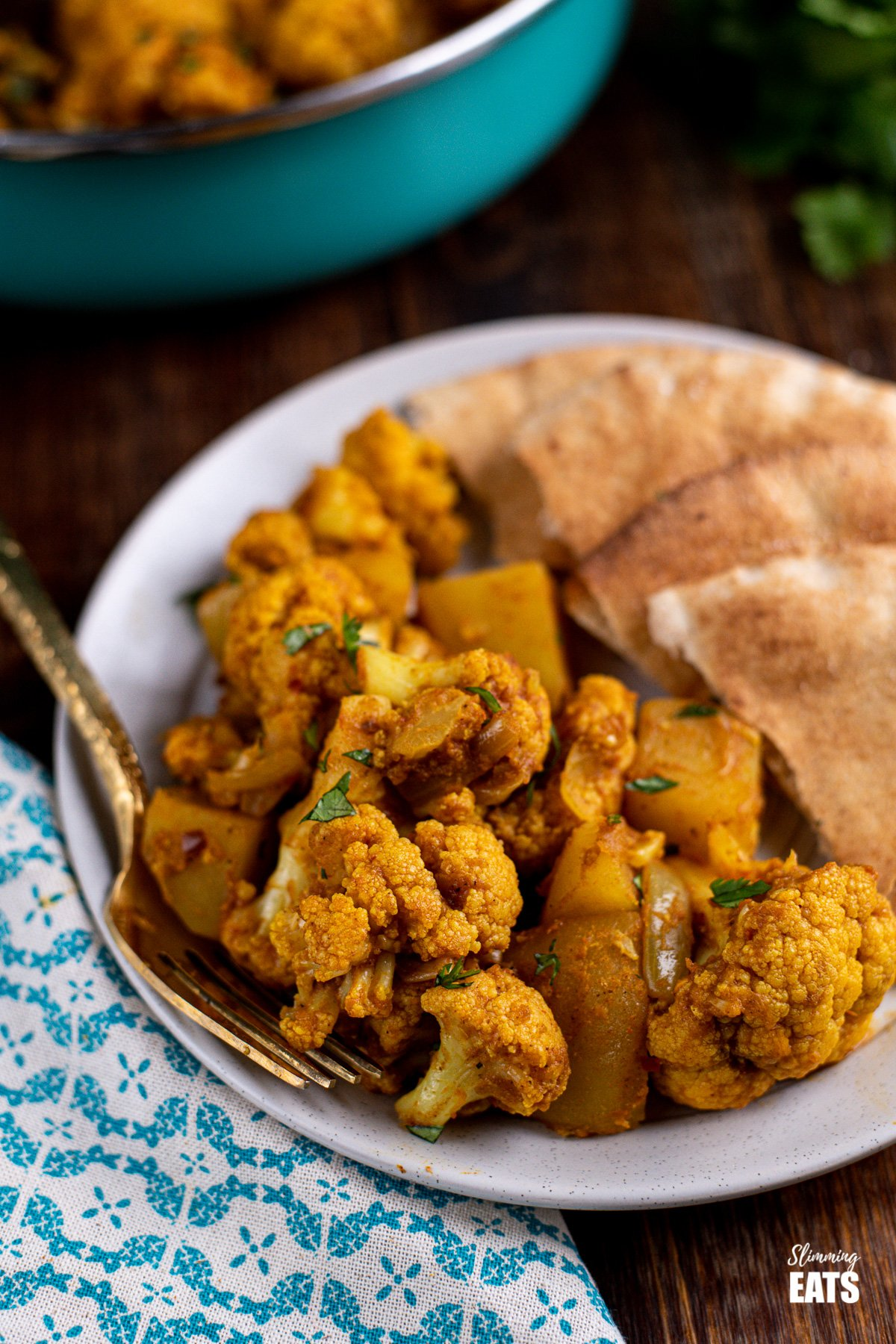 Aloo Gobi on plate with pitta bread