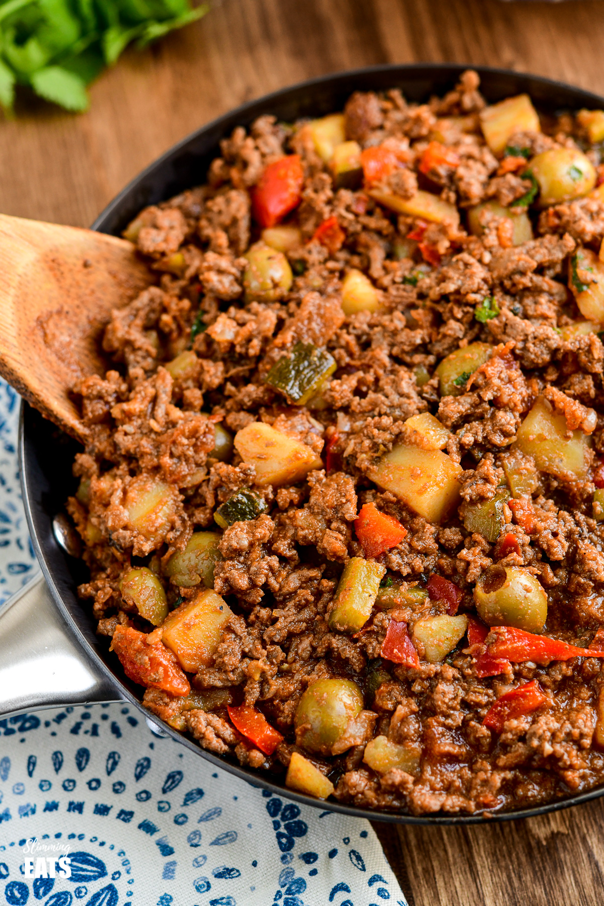 cuban beef picadillo close up in frying pan