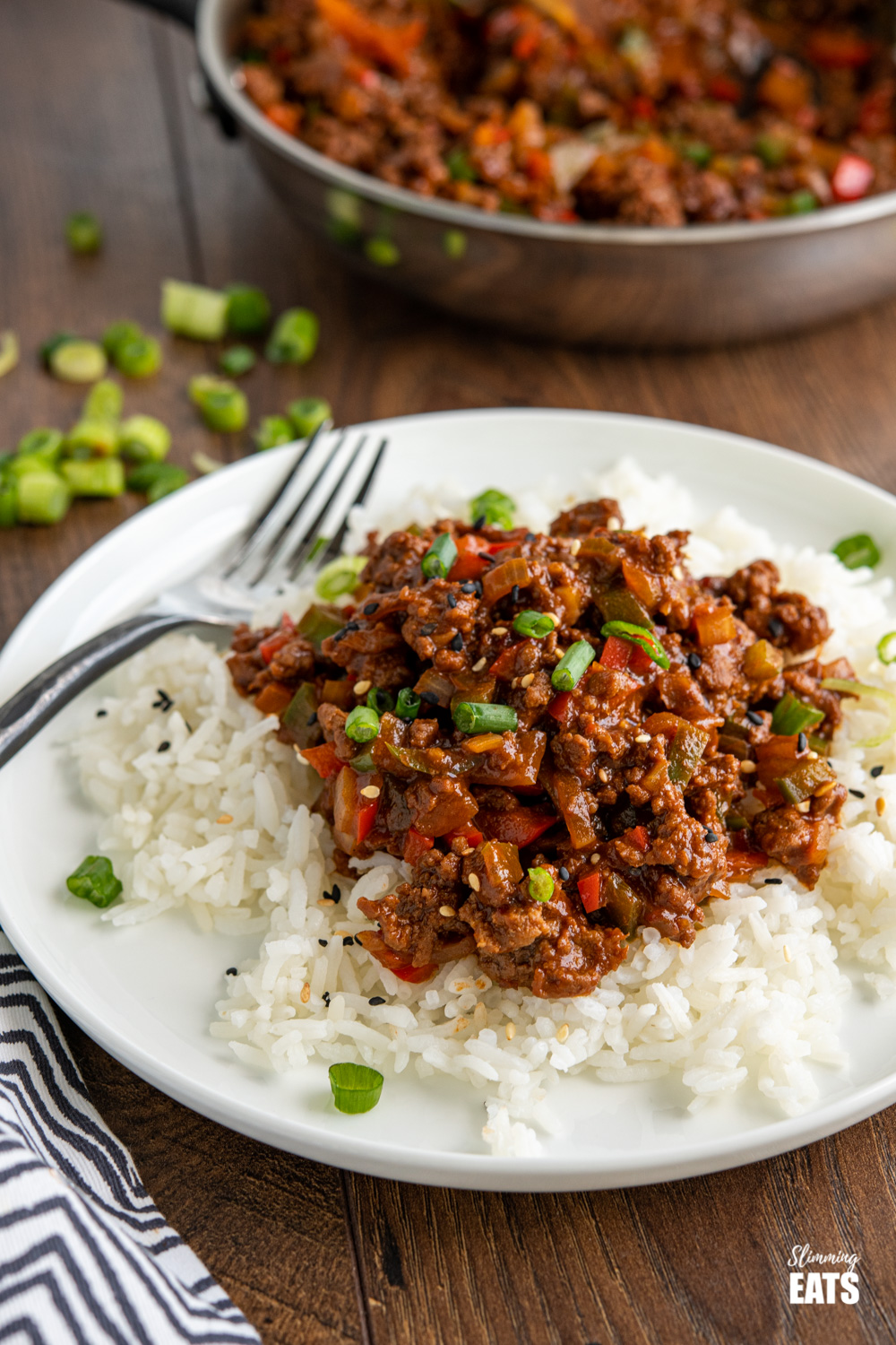 easy asian ground beef over jasmine rice on white plate