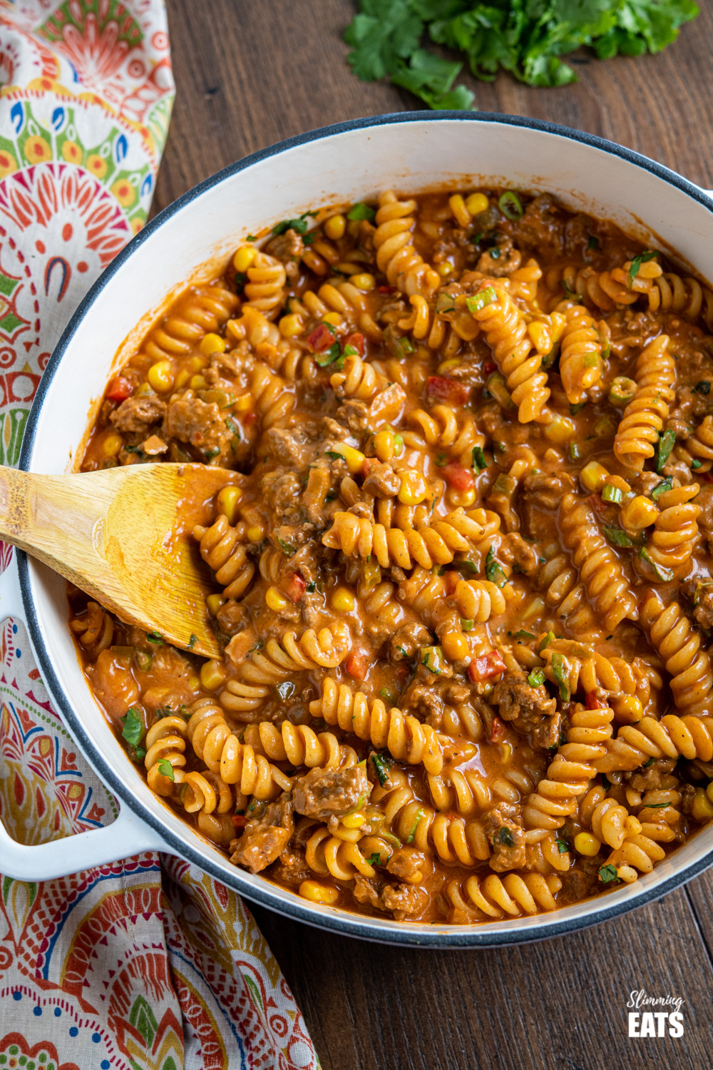 One Pot Taco Beef Pasta in skillet with wooden spoon