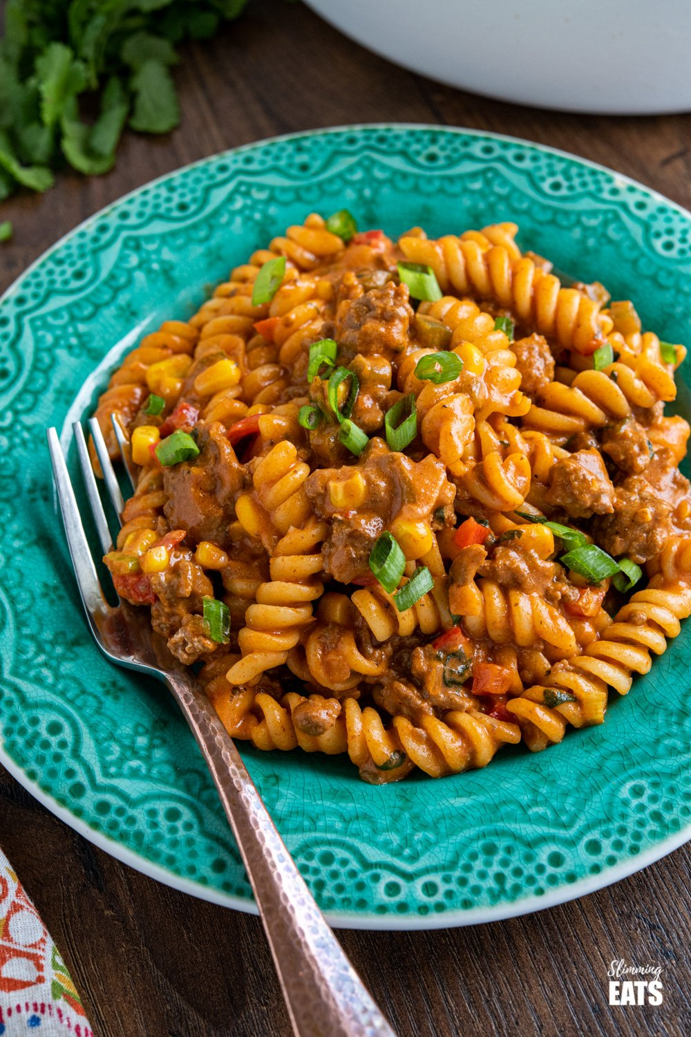 teal plate with serving of one pot taco beef pasta