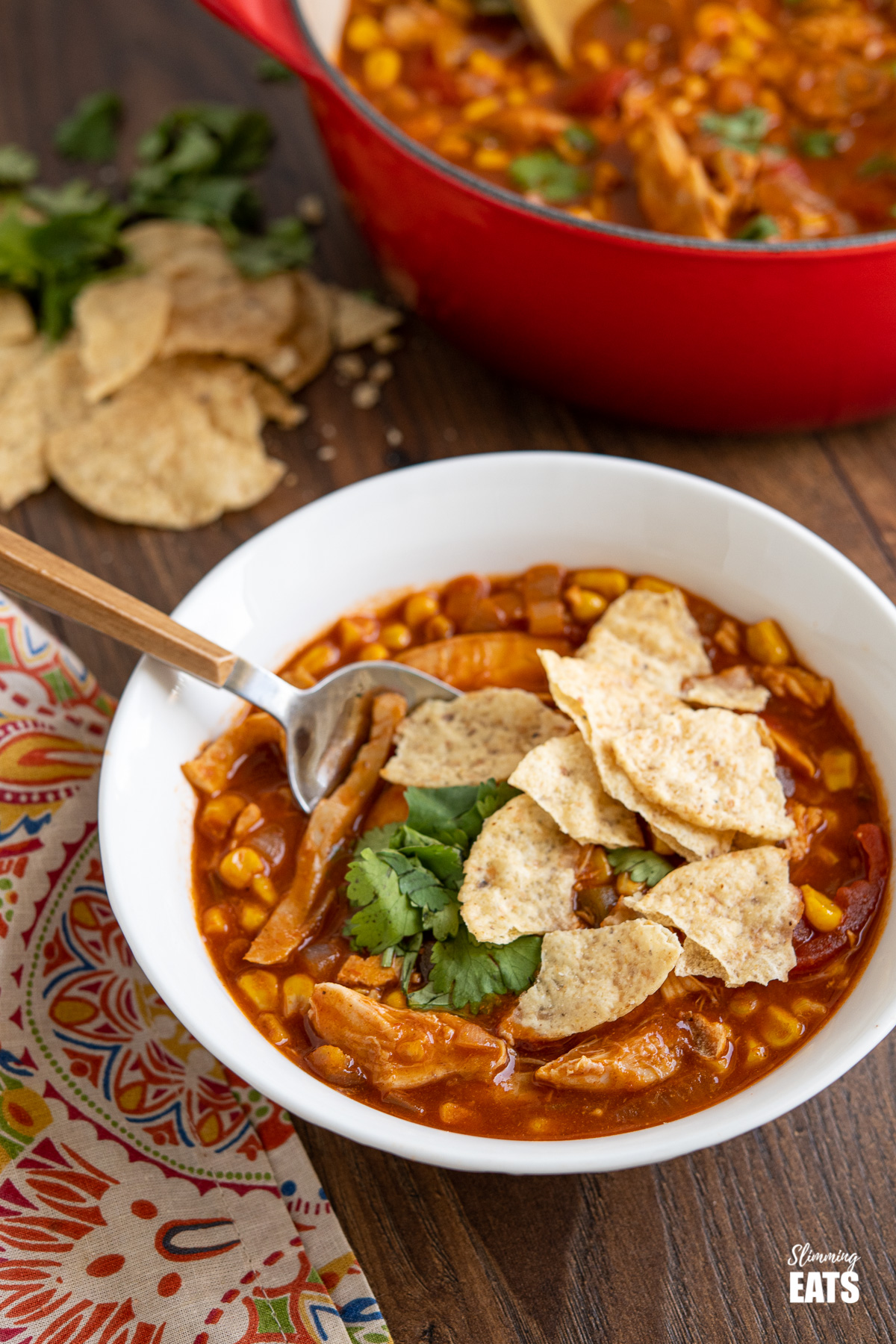 bowl of Easy Chicken Tortilla Soup with crushed tortilla chips