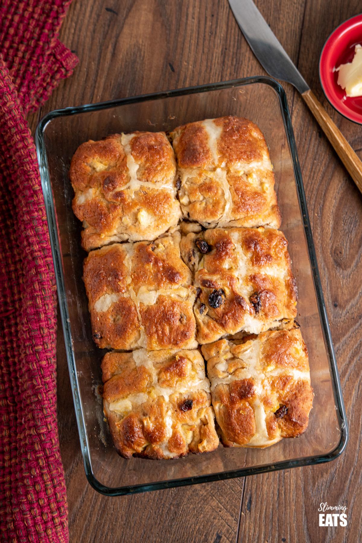 6 hot cross buns in a glass baking dish