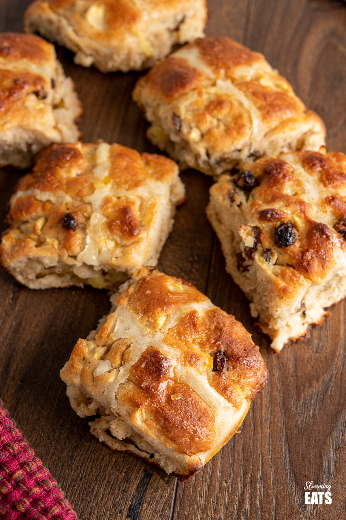 scattered hot cross buns on wooden table