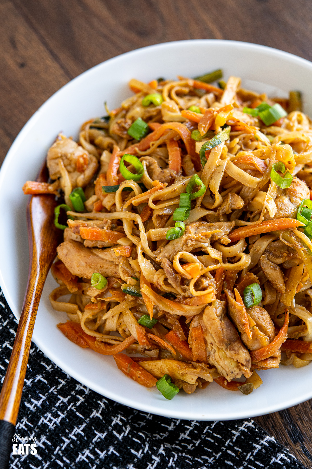 white bowl of easy peanut chicken noodles