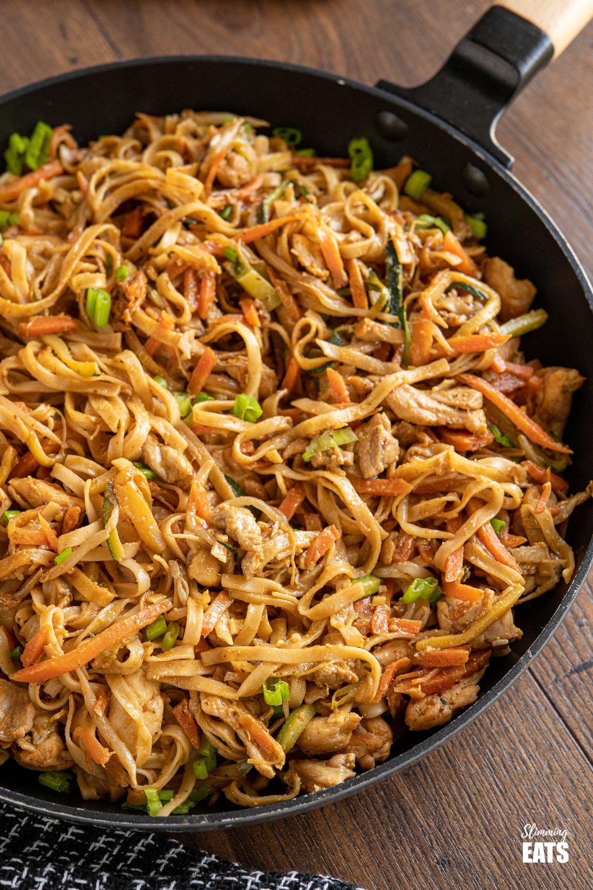Easy Peanut Chicken Noodles in frying pan