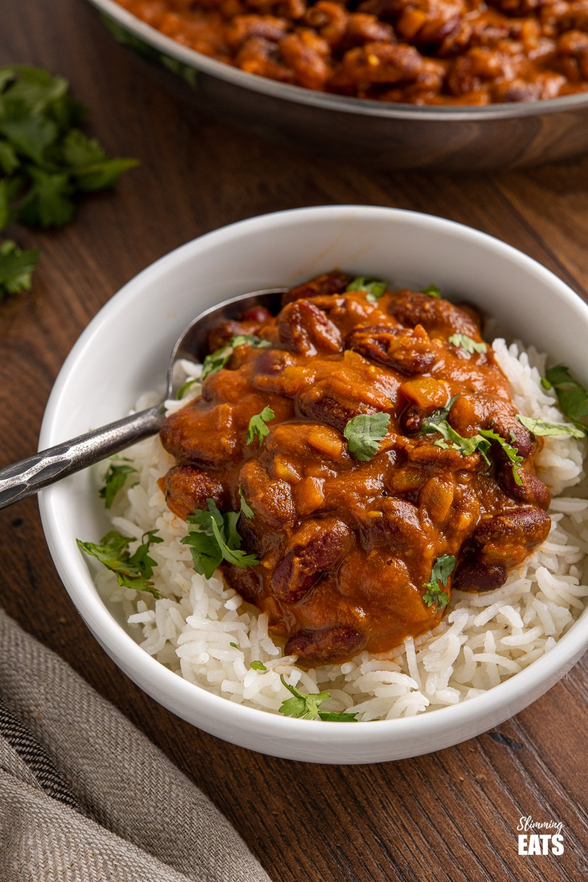 kidney bean curry (rajma) over basmati rice in white bowl