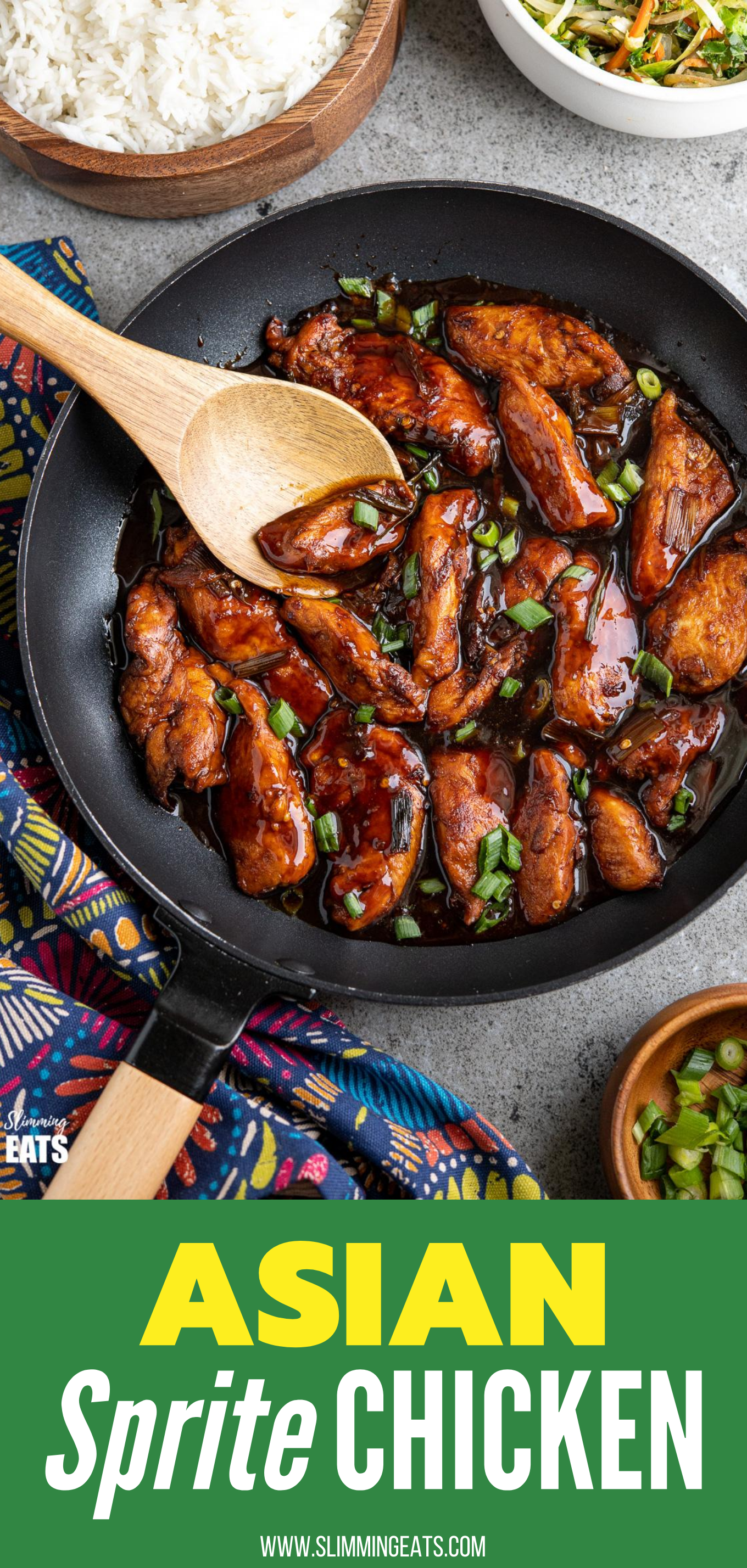 Asian sprite chicken in black pan with wooden handle and wooden spoon, rice and veg in bowls in background
