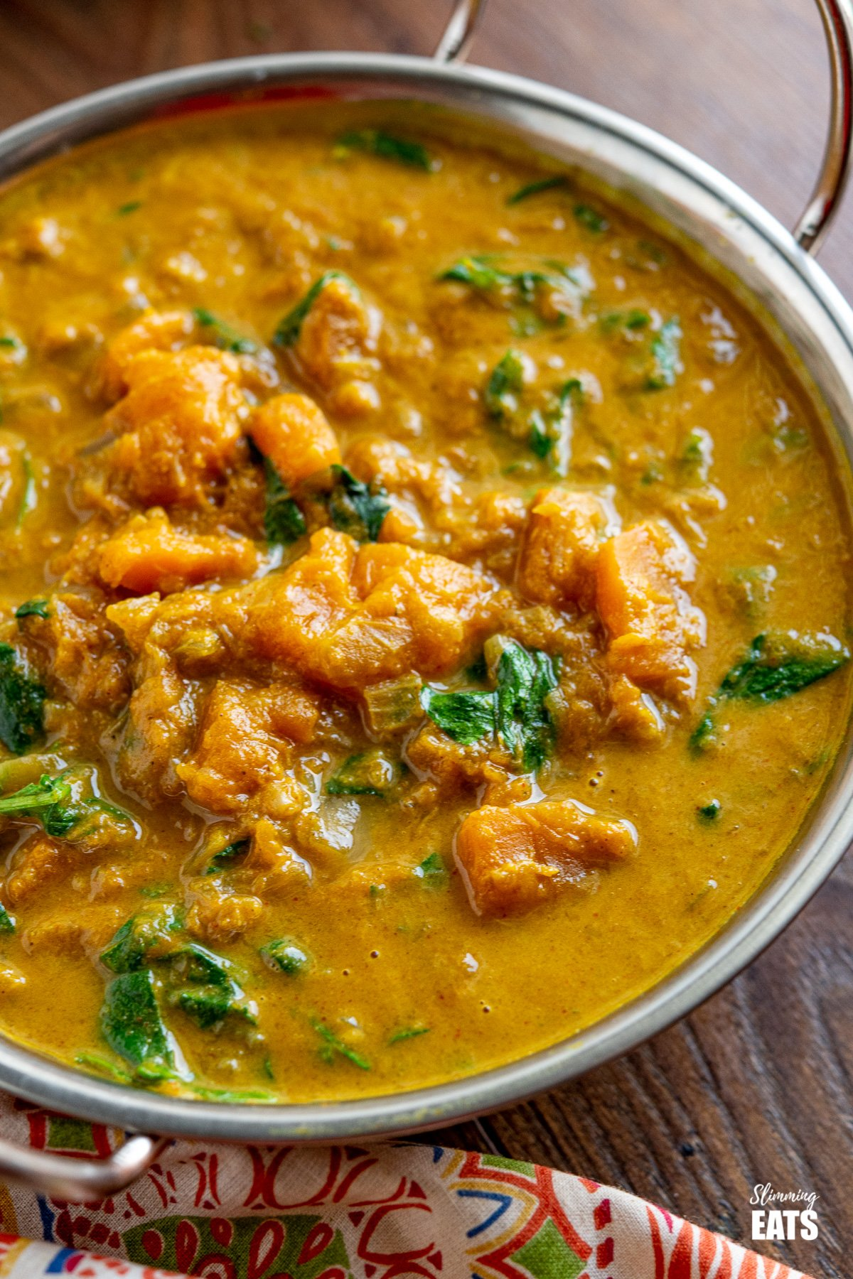 close up of Easy Butternut Squash Curry with Spinach in metal dish