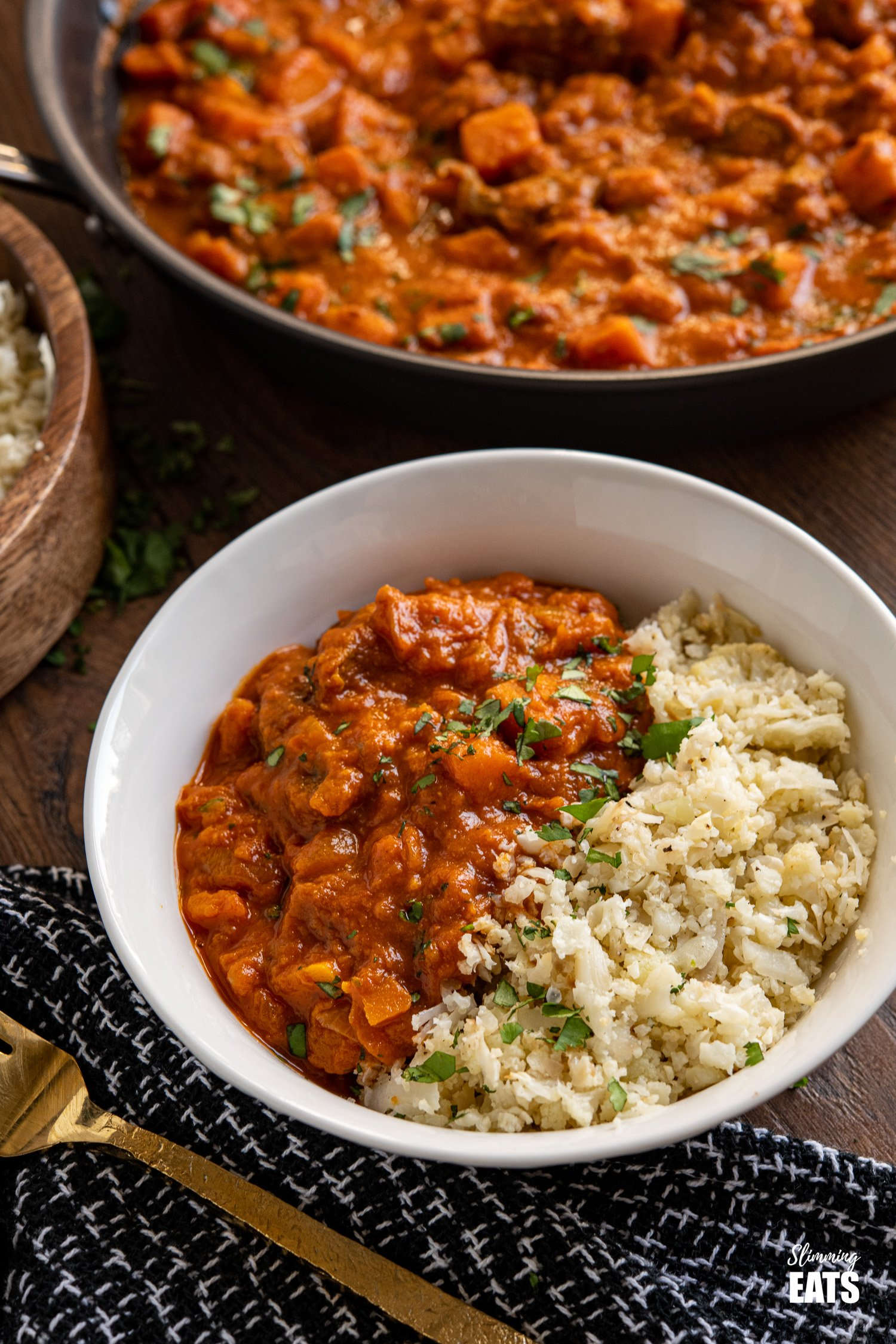 Beef and Sweet Potato Tikka Masala with Cauliflower Rice in a white bowl