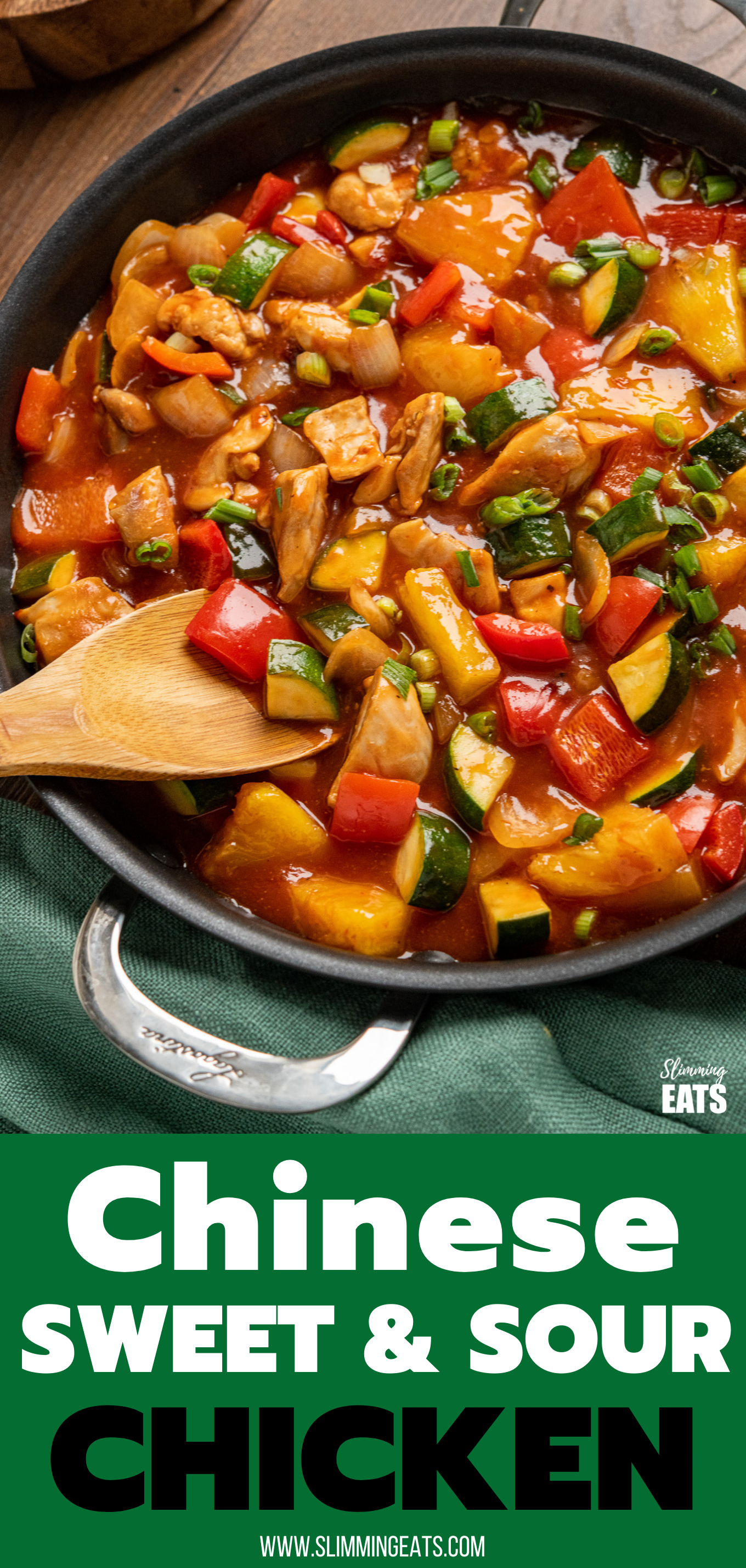 chinese sweet and sour chicken in frying pan with wooden spoon