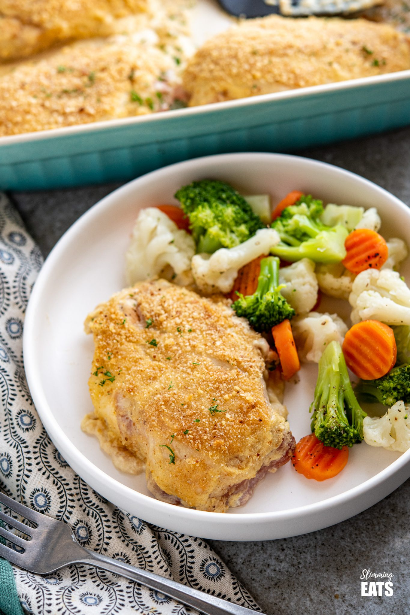 Easy Chicken Cordon Bleu on white plate with steamed vegetables