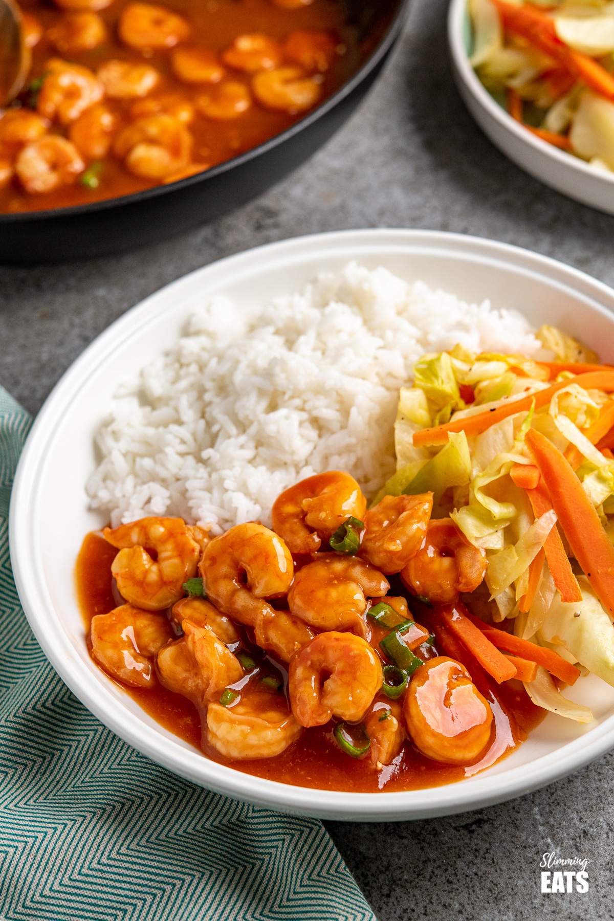 sweet and sour shrimp in white bowl with rice and vegetables