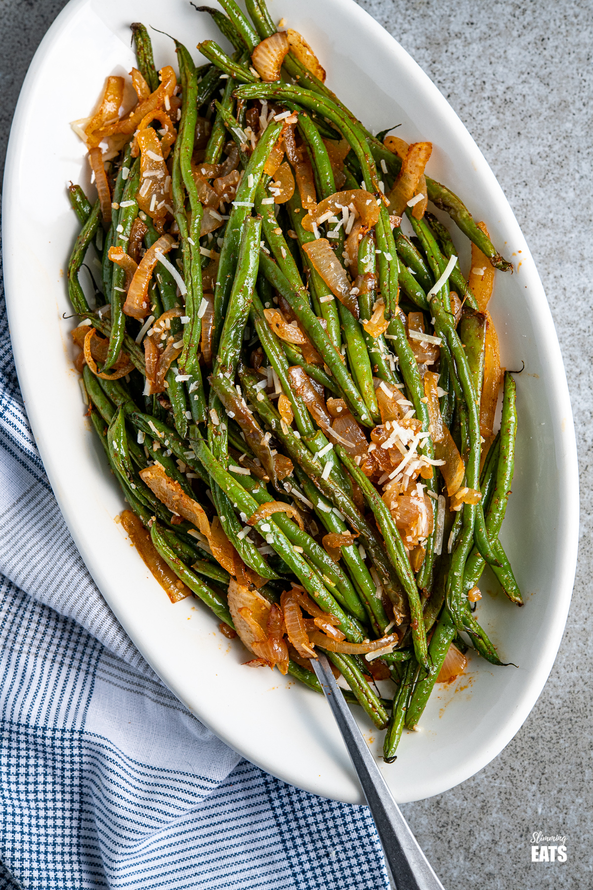 Roasted Green Beans on a oval white plate