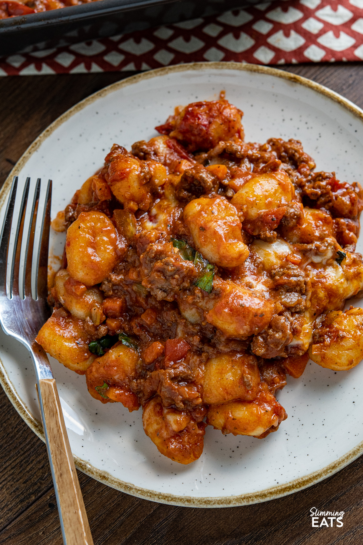 close up of Cheesy Bolognese Gnocchi serving  on plate