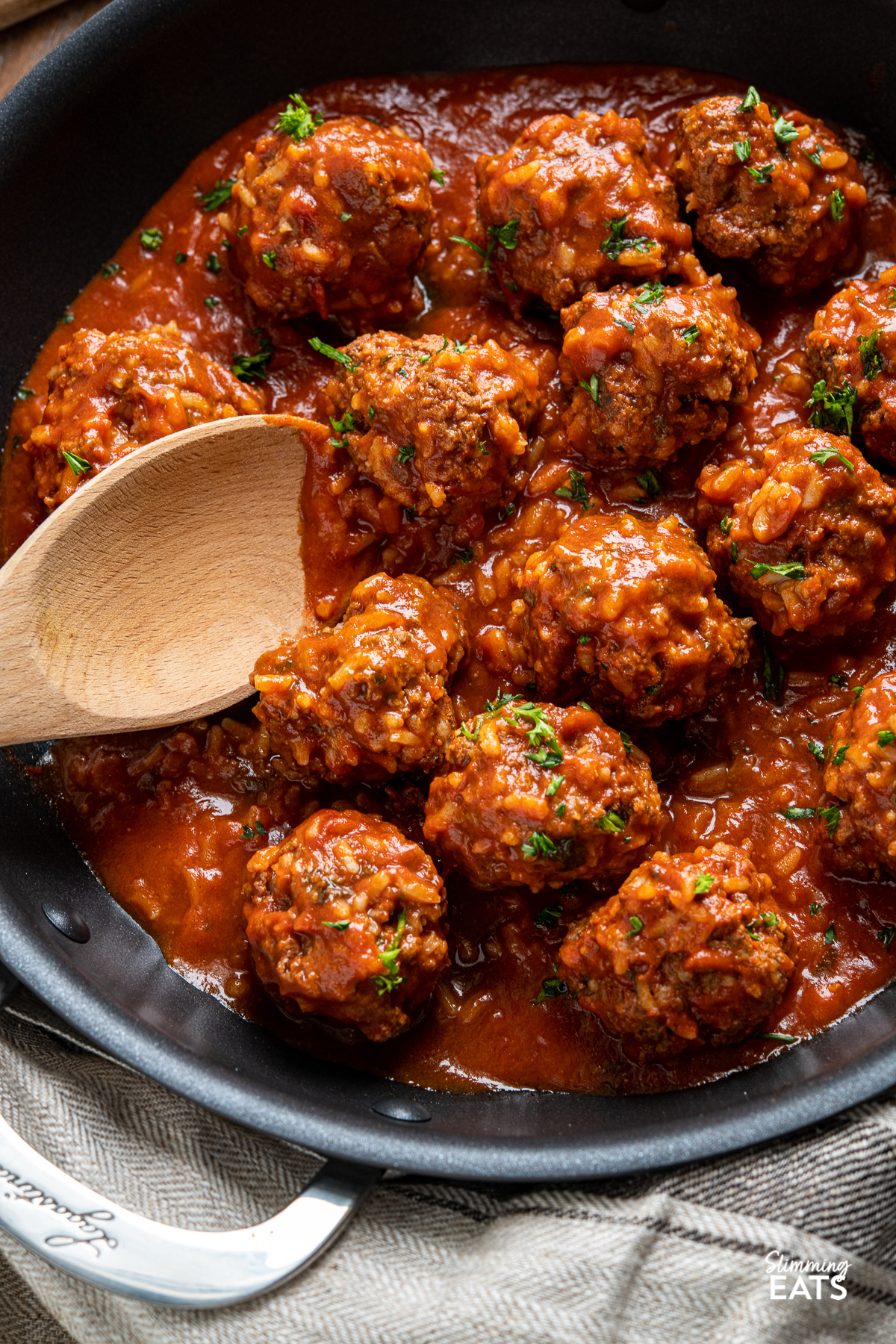 Porcupine Meatballs with wooden spoon in black skillet